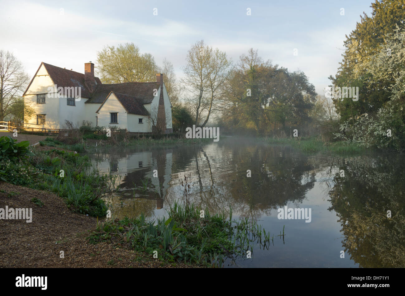 Classic Constable  painting scene at Flatford Mill with mist and refelction Stock Photo