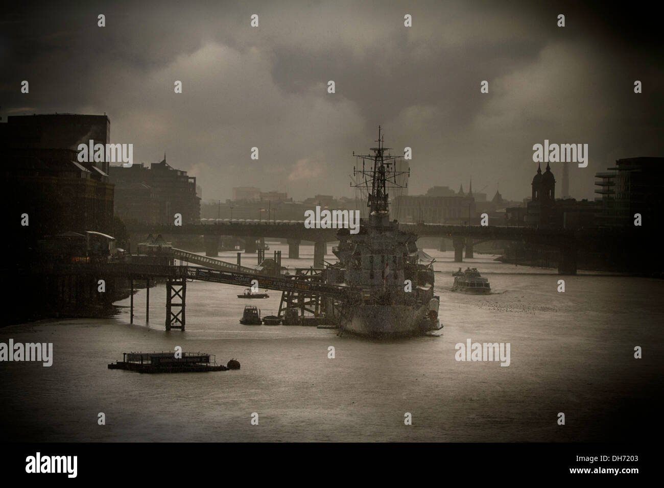 The HMS Belfast moored on the River Thames. - Stock Image