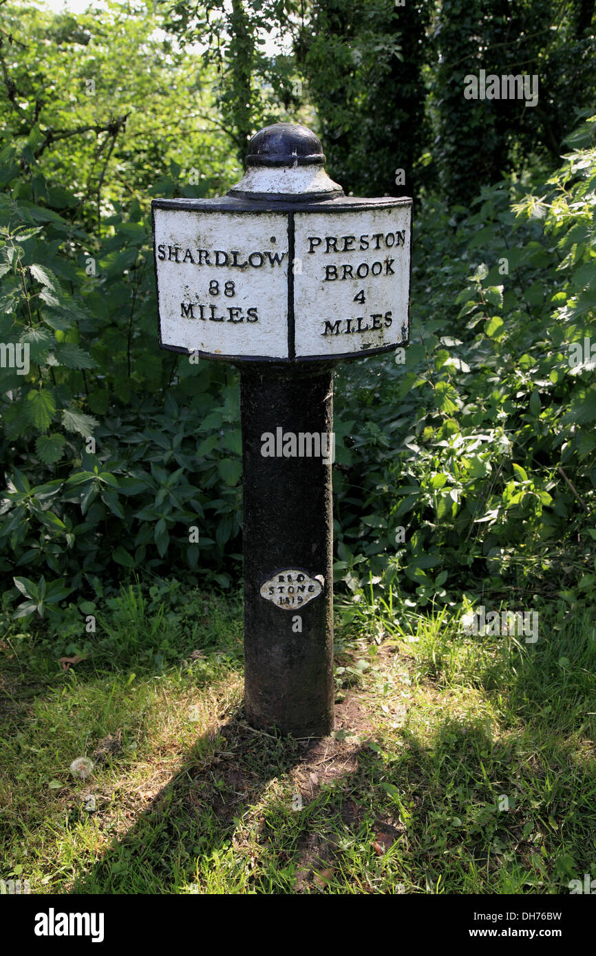 A mile post dating from 1819 near the western portal of Saltersford Tunnel on the Trent and Mersey Canal near Barnton, Cheshire - Stock Image