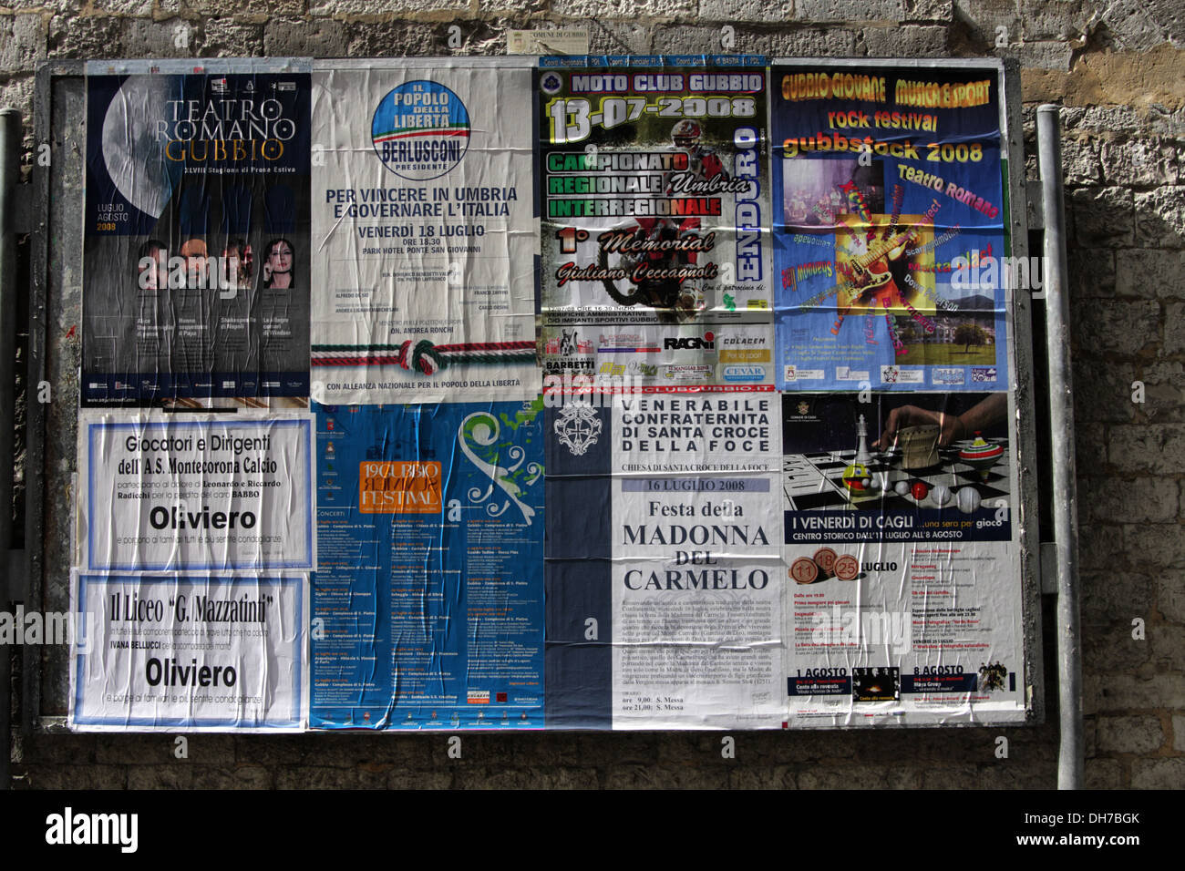 Posters on the wall of an Italian town - Stock Image