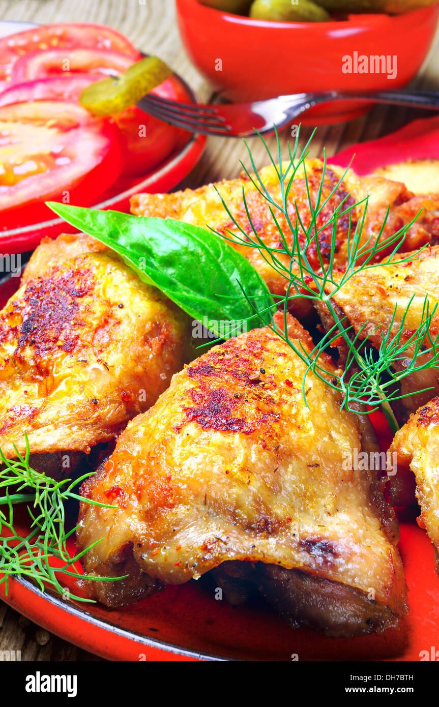 Roast chicken on a plate closeup - Stock Image