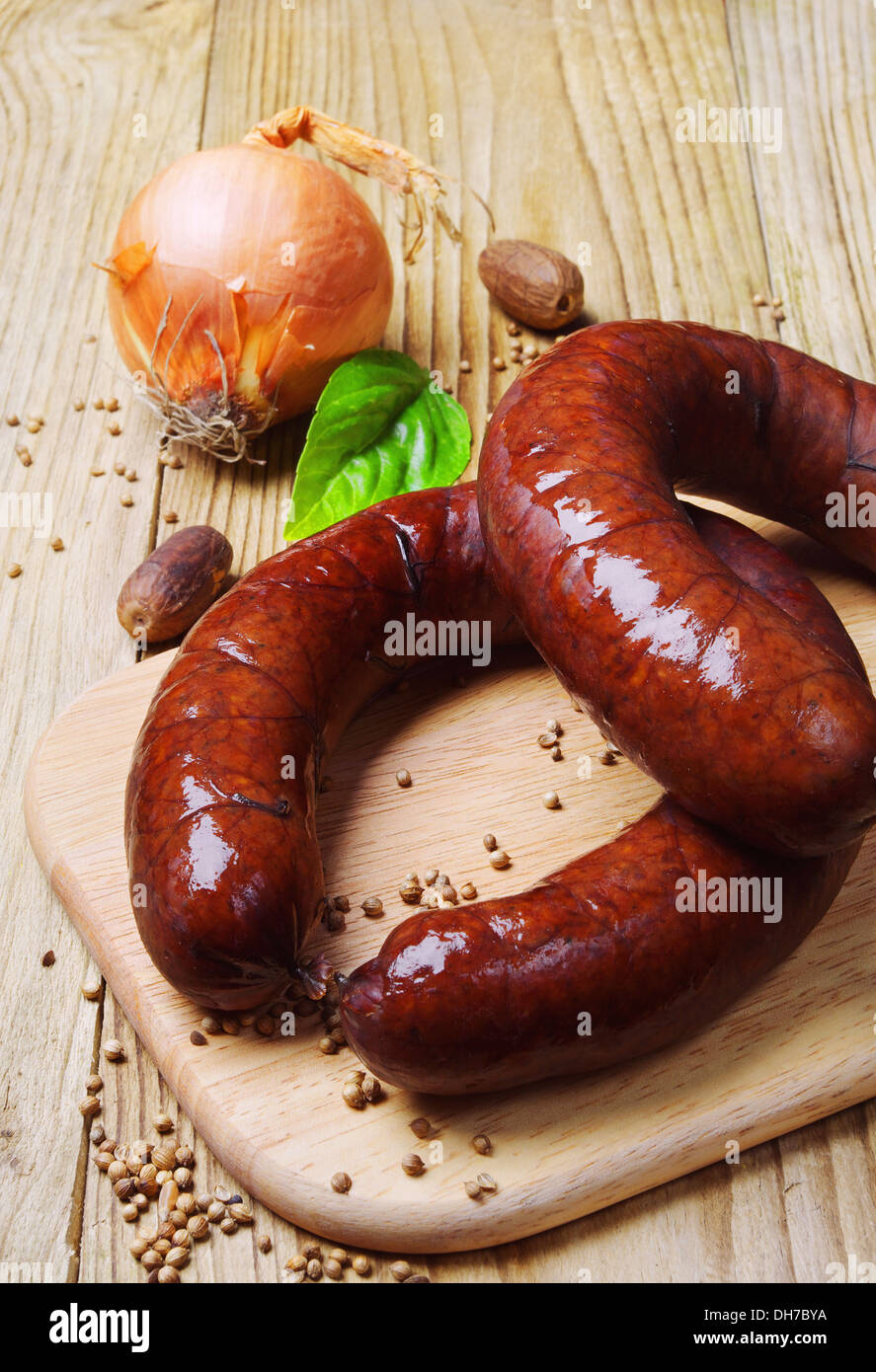 Homemade smoked sausage and onion on a cutting board Stock Photo