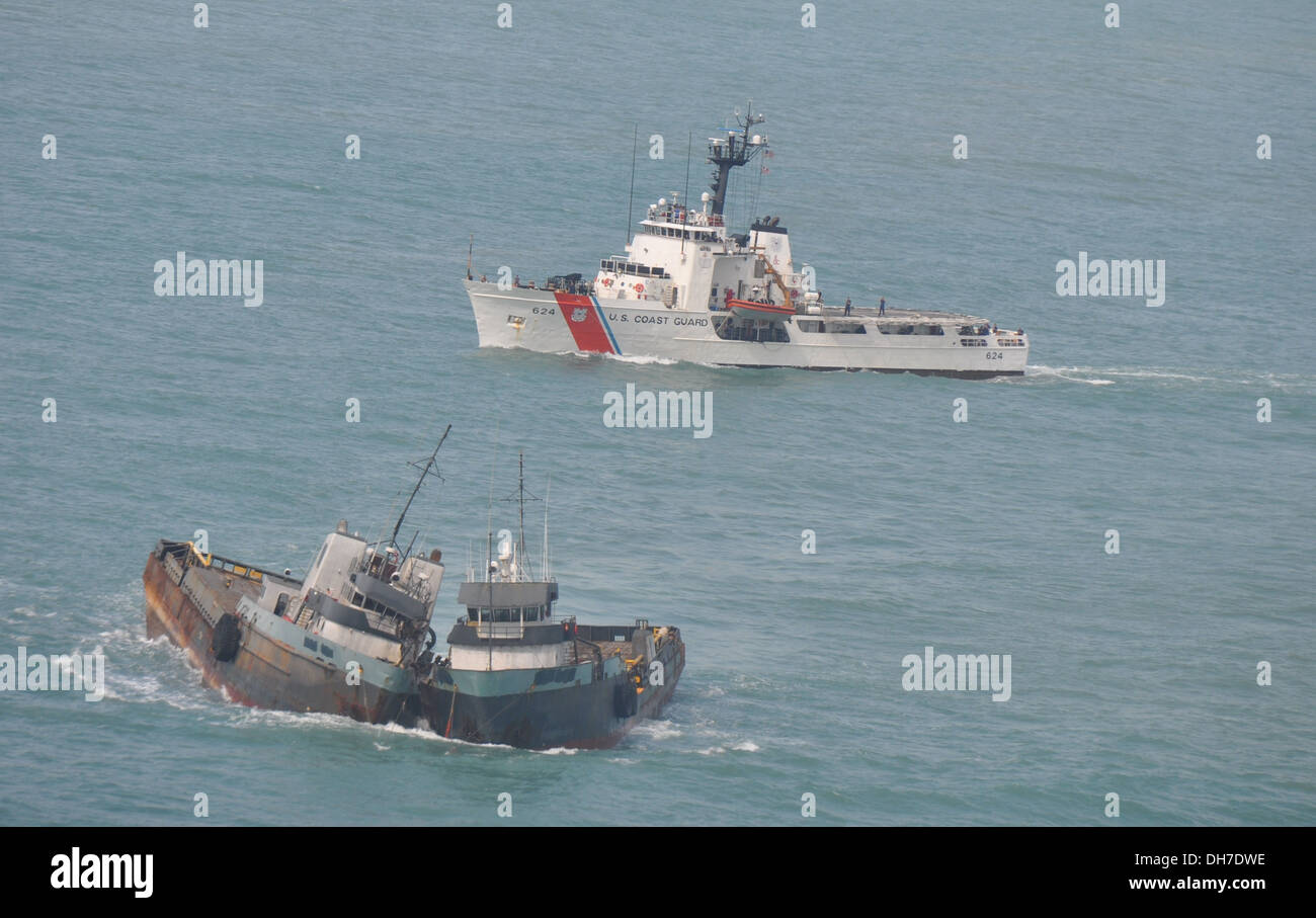 Coast Guard Cutter Dauntless arrives on scene, Thursday, Oct. 31, to assist and escort the tug vessel Lacheval after the captain contacted the Coast Guard reporting the vessels he had in tow were listing into each other. - Stock Image