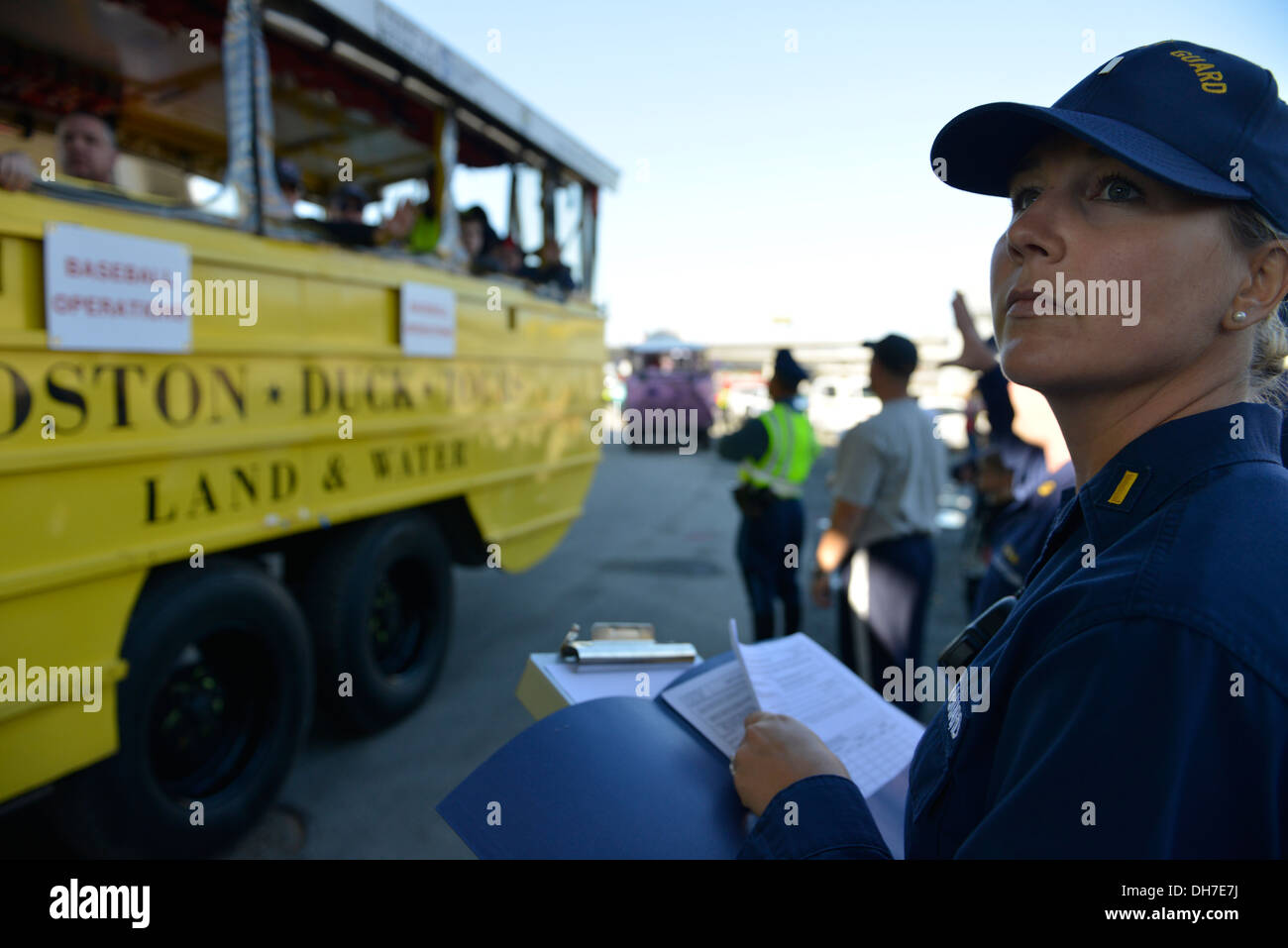 Ens. Nicole Emmons, from the Coast Guard Sector Boston Prevention Office, inspects a duck boat before it enters the Charles River during the Red Sox parade in Boston Nov. 2, 2013. The boats were inspected prior to entering the water to ensure they could s - Stock Image