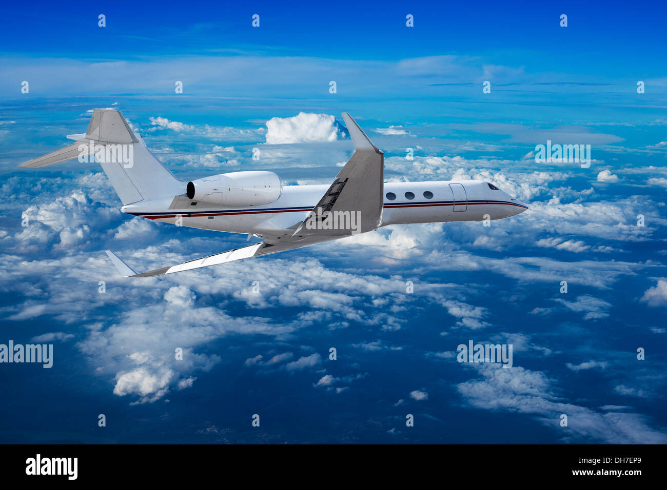 Private jet cruising above the clouds - Stock Image