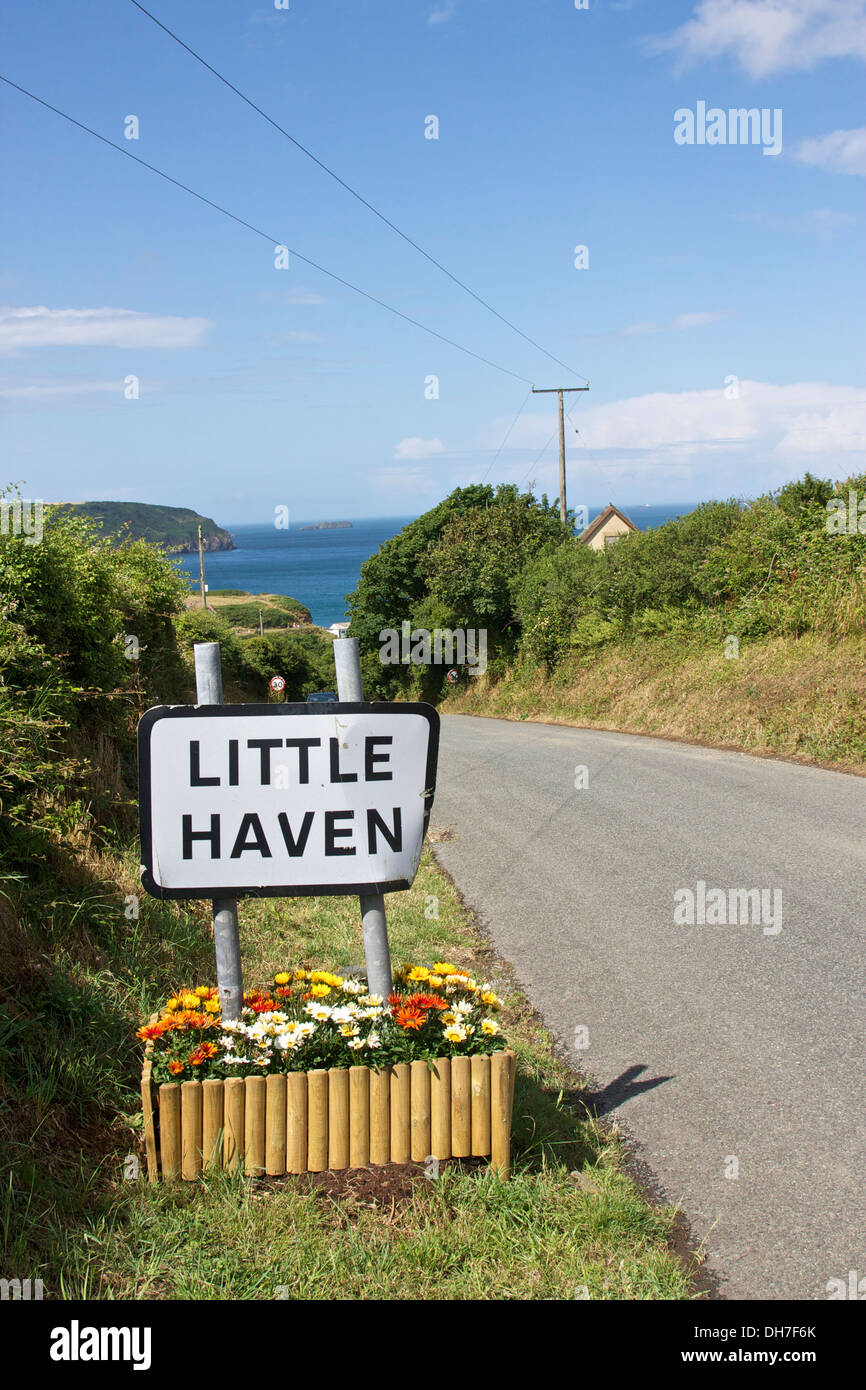 Road sign at entrance to Little Haven, Pembrokeshire, Wales. - Stock Image