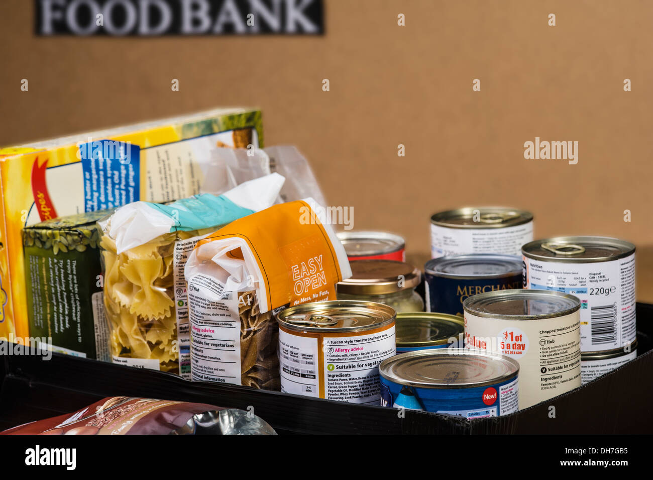Box of essential food items ready to be handed out.Food bank charity donation. - Stock Image