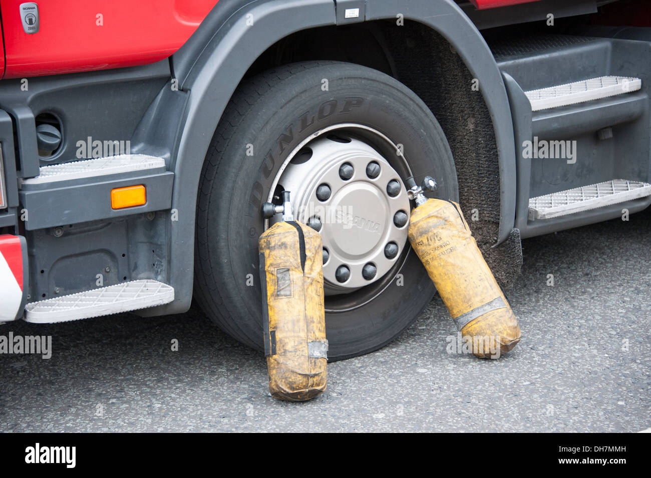 2 BA Cylinders against wheel of Fire Engine Truck - Stock Image