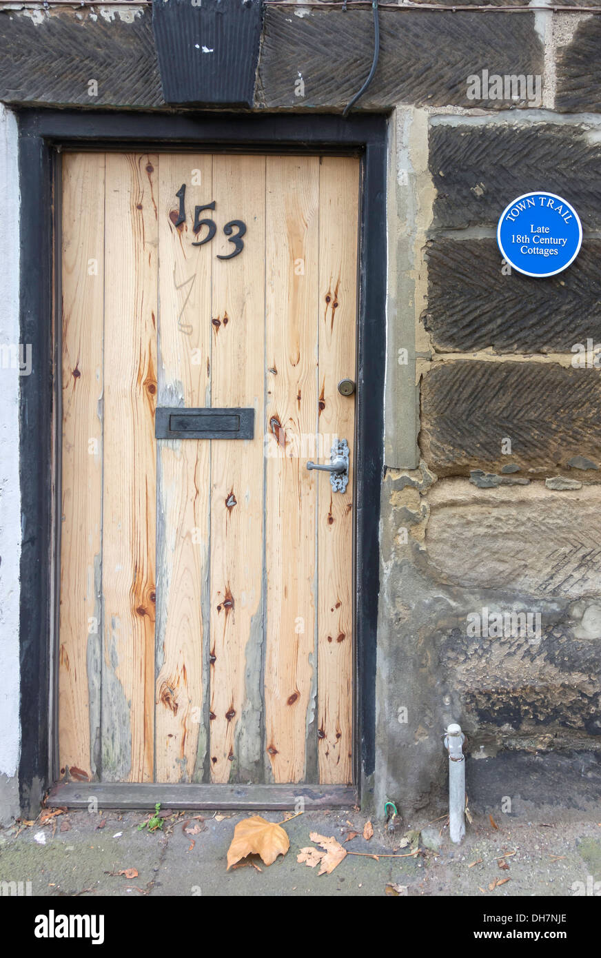 Front door of a late 18th century cottage with a Blue Plaque on the Town Trail in Guisborough ancient capital of Cleveland UK & Front door of a late 18th century cottage with a Blue Plaque on the ...