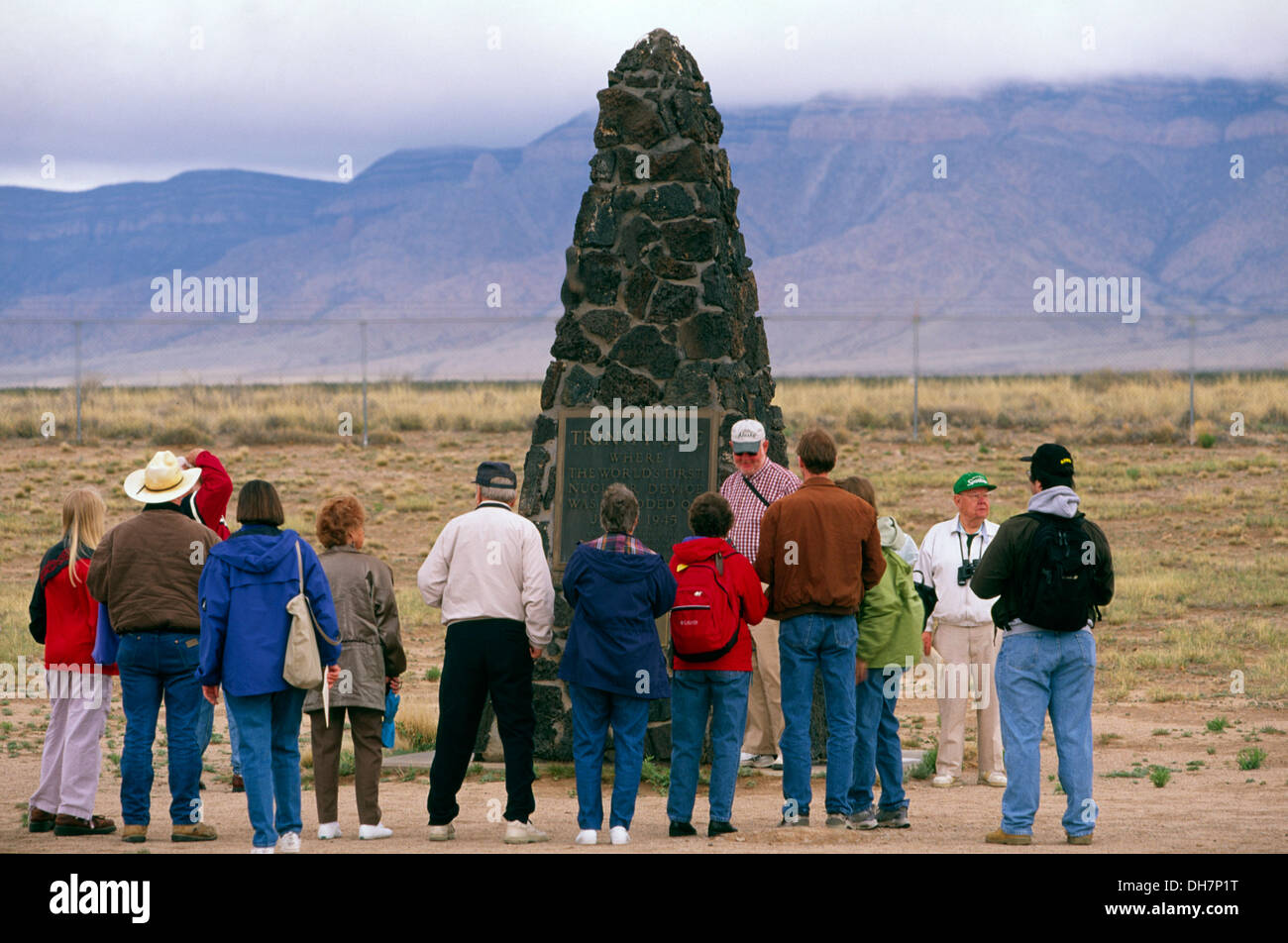 Visitors around stone marker at Trinity Site where first nuclear explosion took place in 1945, New Mexico, USA - Stock Image