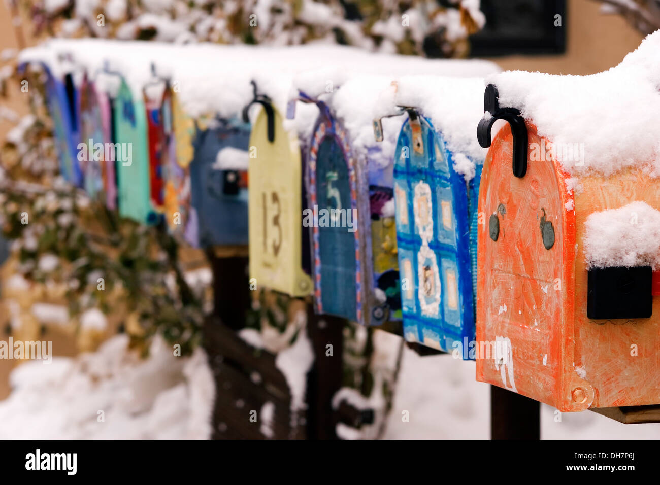 Colorful mailboxes covered in snow, Canyon Road, Santa Fe, New Mexico USA - Stock Image