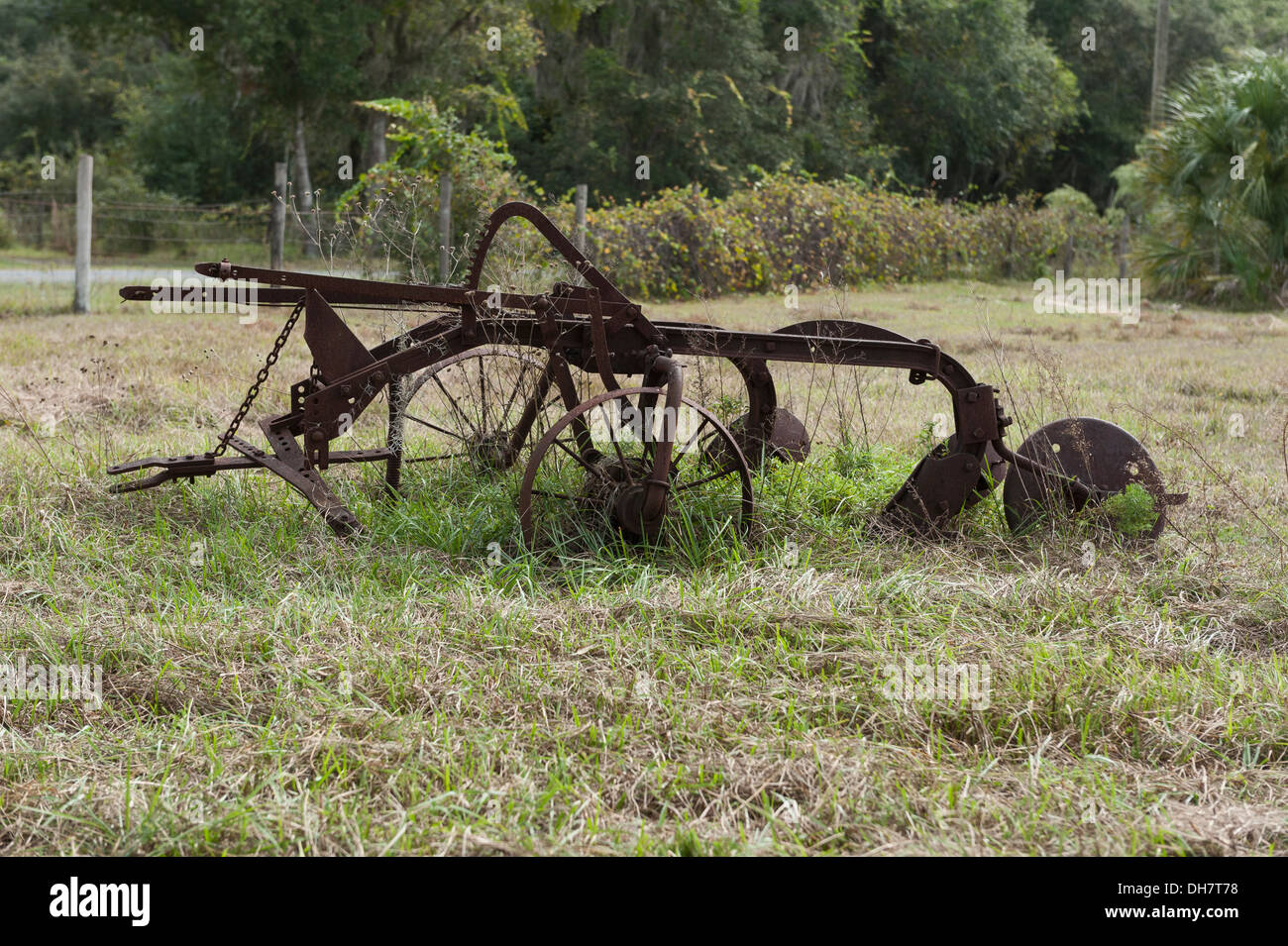 An antique farm plowing attachment sitting in a  pasture. Leesburg, Florida USA - Stock Image