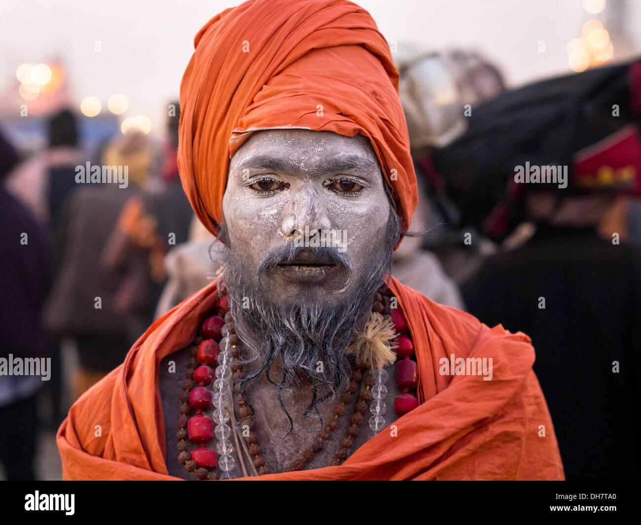 Orange-robed Indian sadhu at Kumbh Mela 2013, the world's largest religious festival in Allahabad, India. - Stock Image