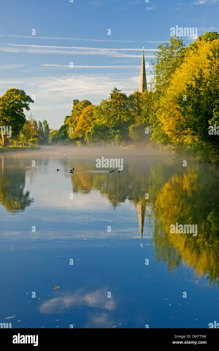 Autumnal reflections on the River Avon, with a view towards Holy Trinity church, burial place of William Shakespeare Stratford upon Avon - Stock Image