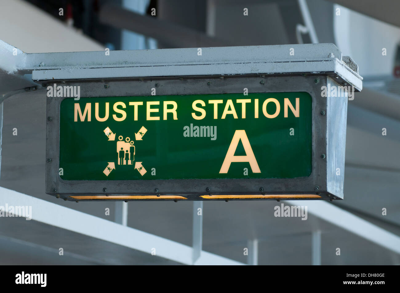 Muster station sign directing passengers to the life boats - Stock Image
