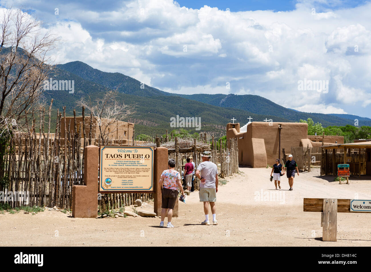 Tourists at the entrance to historic Taos Pueblo, Taos, New Mexico, USA - Stock Image