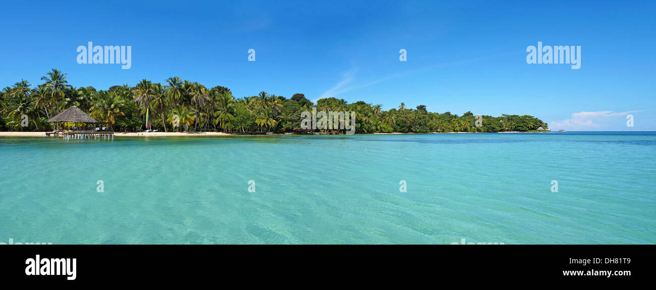 Tropical island panoramic with calm sea and blue sky, Caribbean, Panama - Stock Image