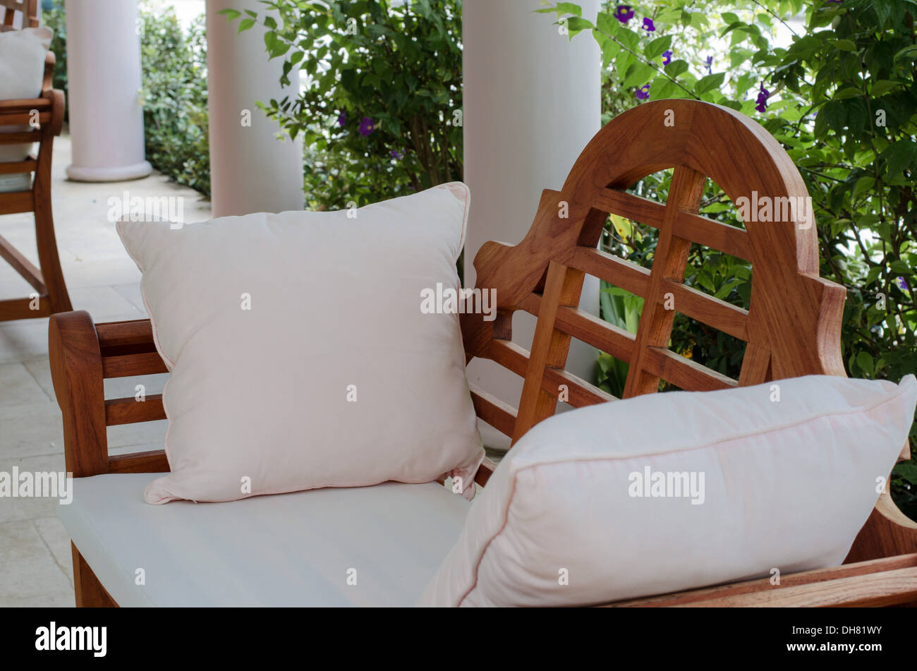 Swell Outdoor Wooden Bench With White Pillows Stock Photo Evergreenethics Interior Chair Design Evergreenethicsorg