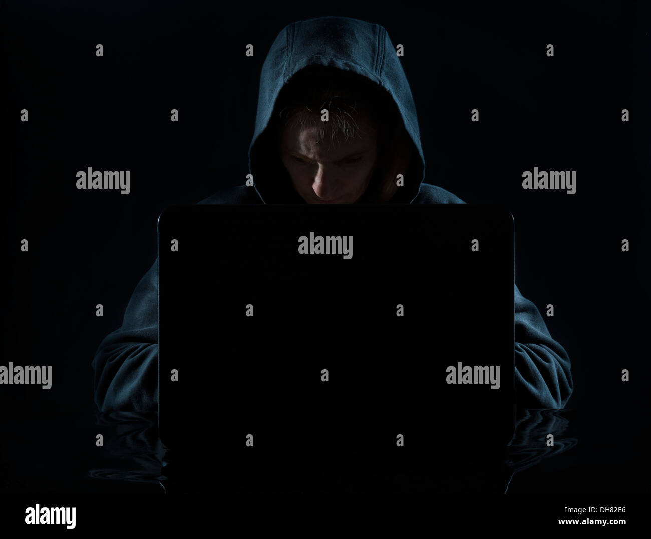 Concept photo of a computer hacker in a hoodie - Stock Image