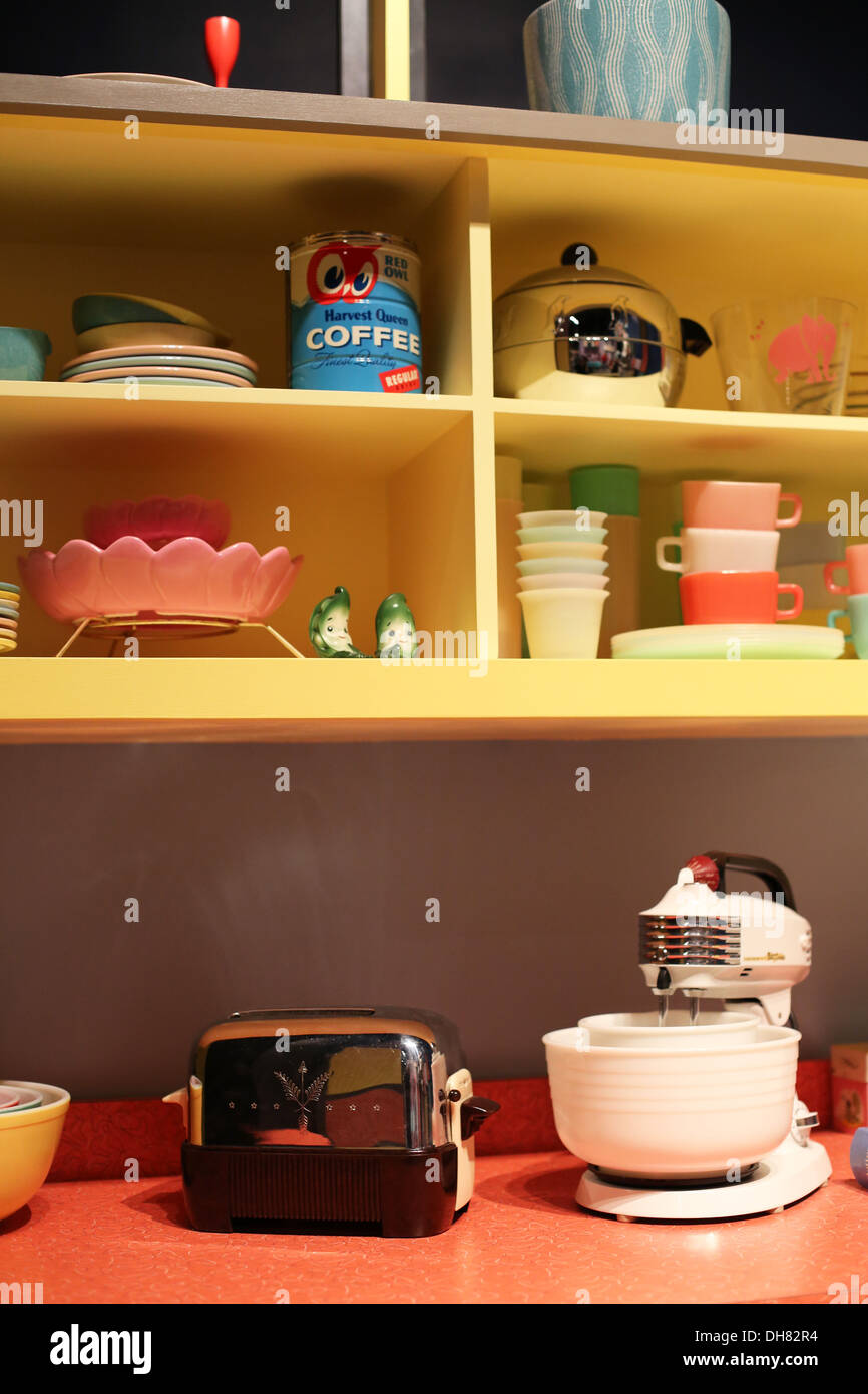 A fifties style kitchen counter and cupboard. - Stock Image