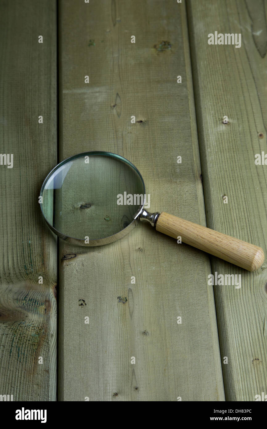 Magnifier magnify glass wood handle magnifiers - Stock Image