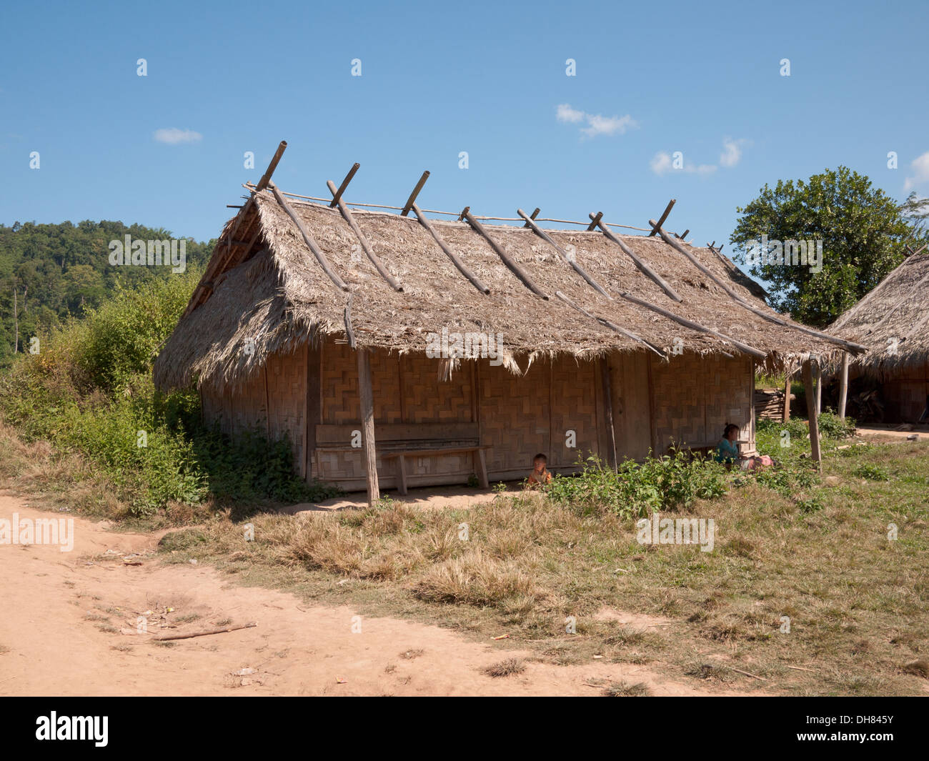 A thatched hut in a village at the start of The Gibbon Experience in Bokeo Nature Reserve, Laos. - Stock Image