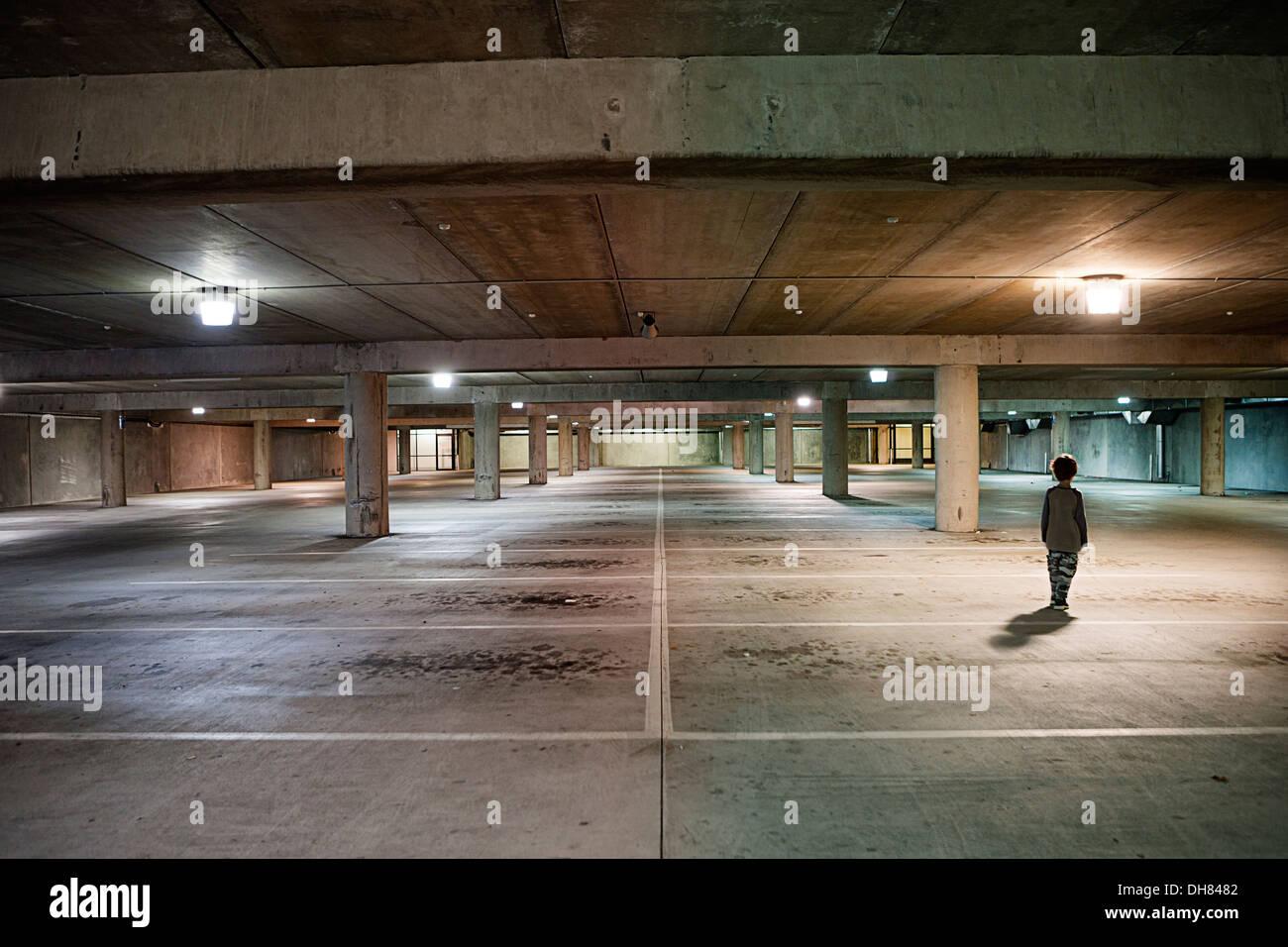 Boy in underground car park - Stock Image