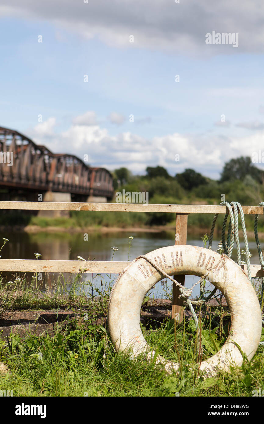 Railway bridge over the border river Oder, Polish-German border, Kuestrin to Kostrzyn, life buoy with the inscription Stock Photo