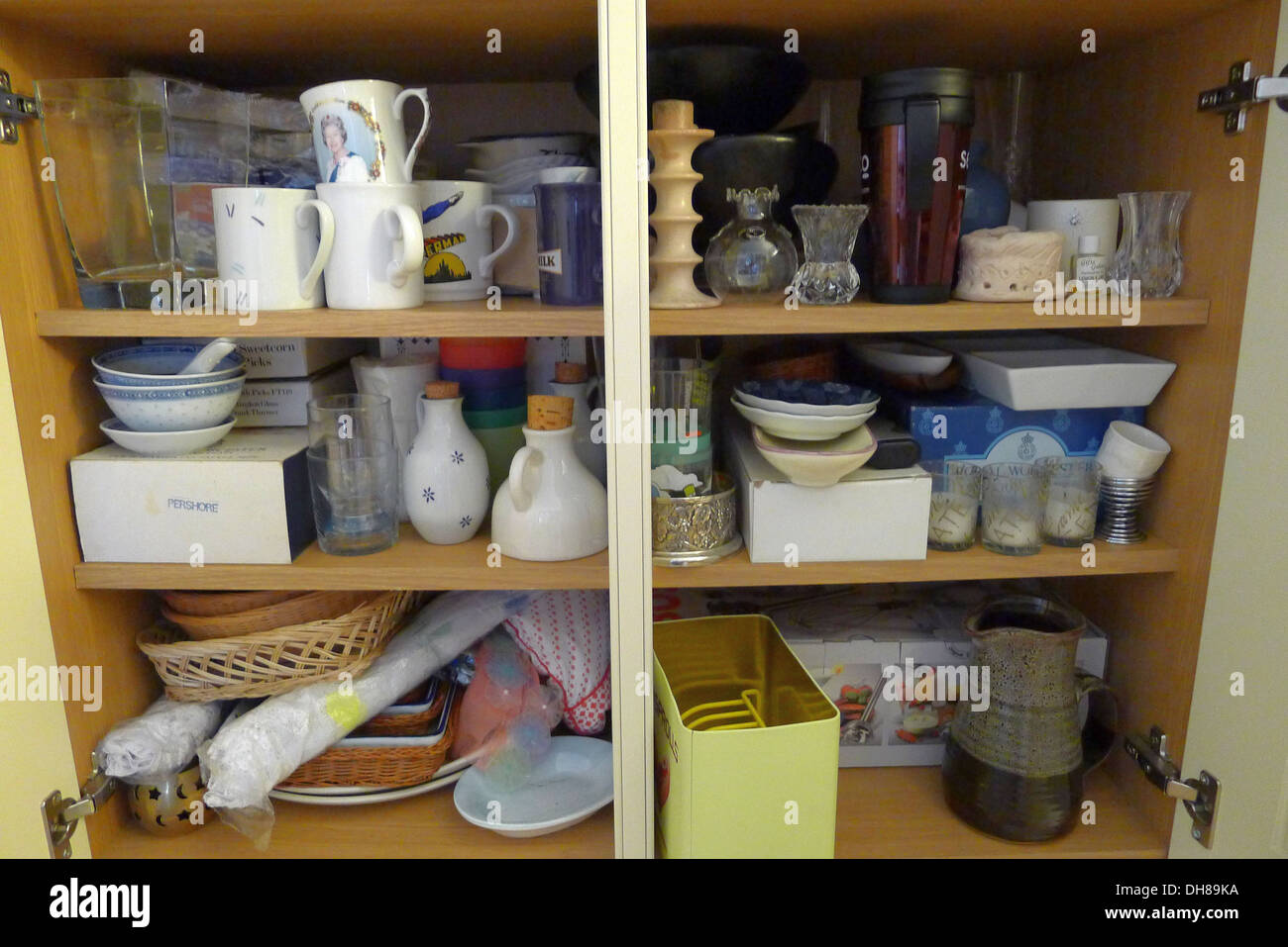 Messy Kitchen Cupboard - Stock Image