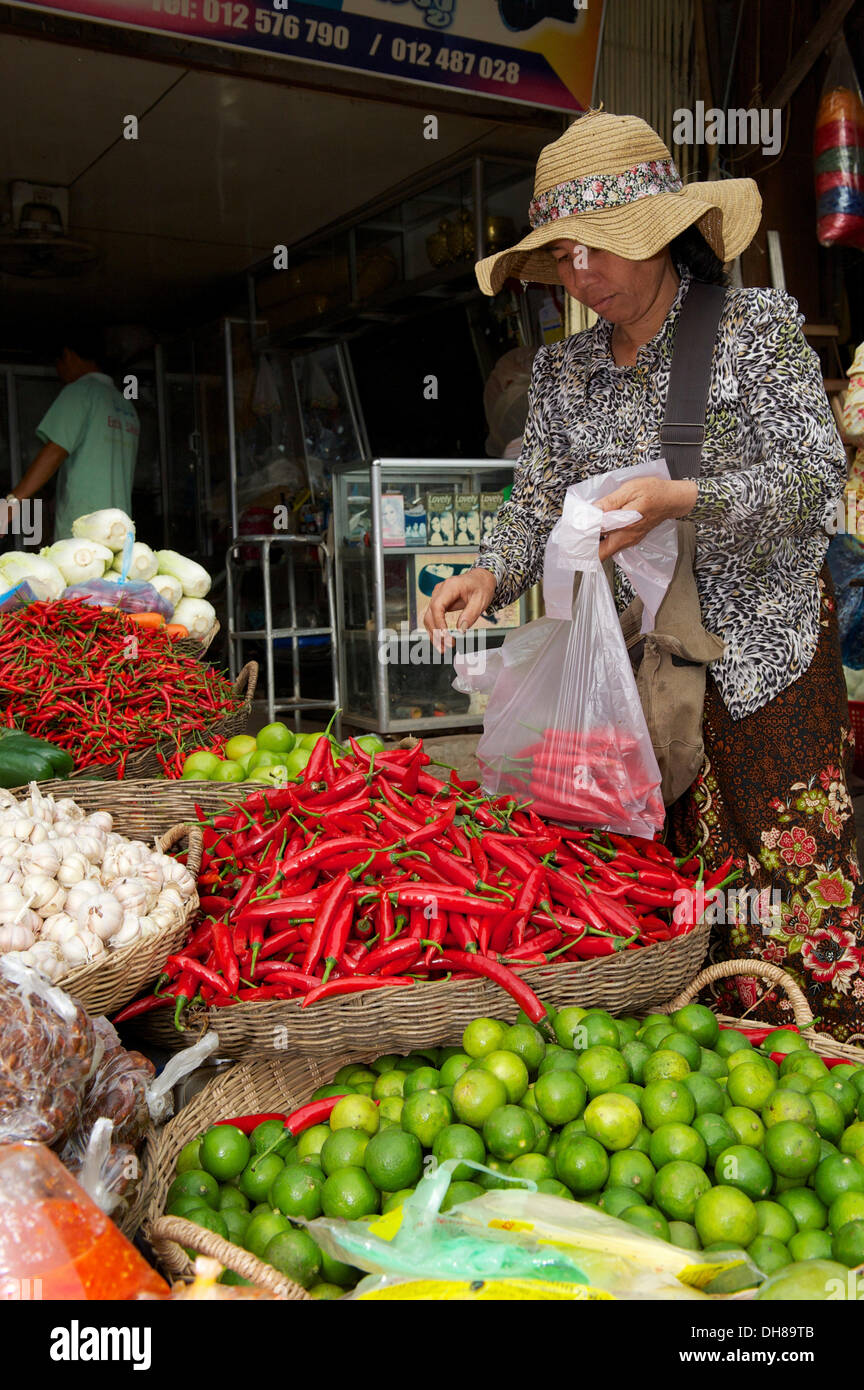 Woman buying chili peppers at a market stall, Siem Reap, Siem Reap, Siem Reap Province, Cambodia - Stock Image