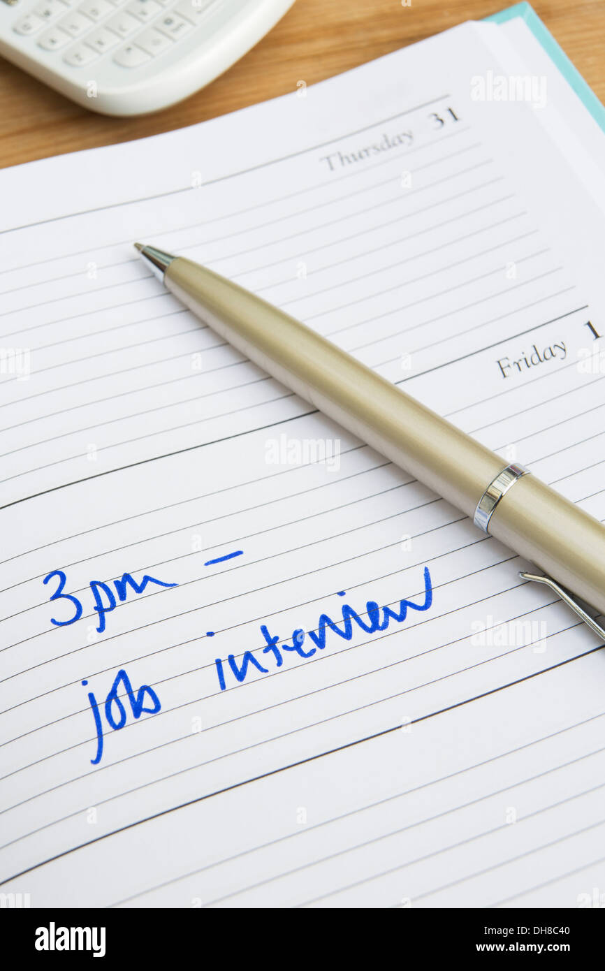 Diary With Time Of Interview Written In Stock Photo