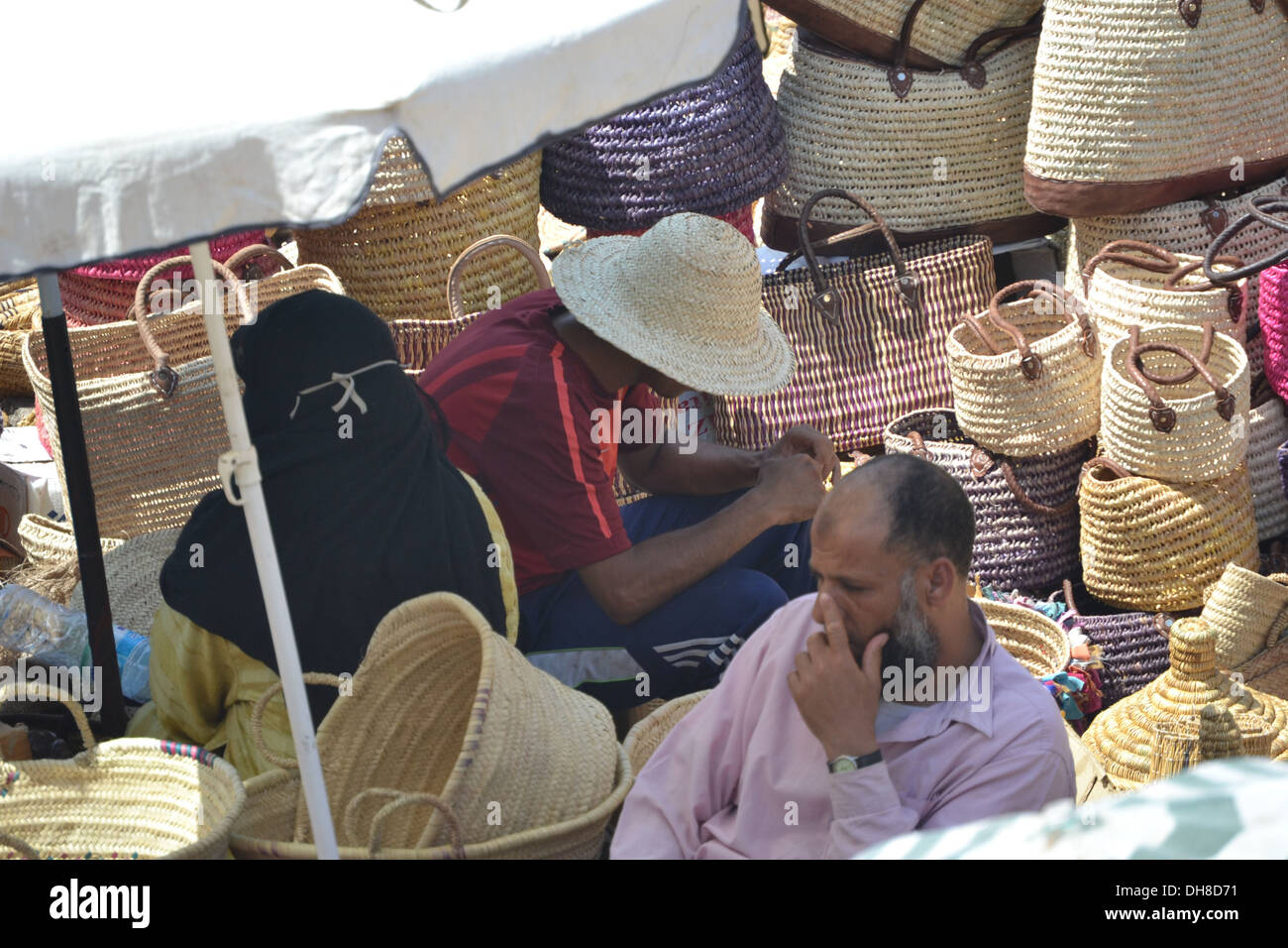 Men selling baskets and weaving works in Marrakech, Morocco. - Stock Image