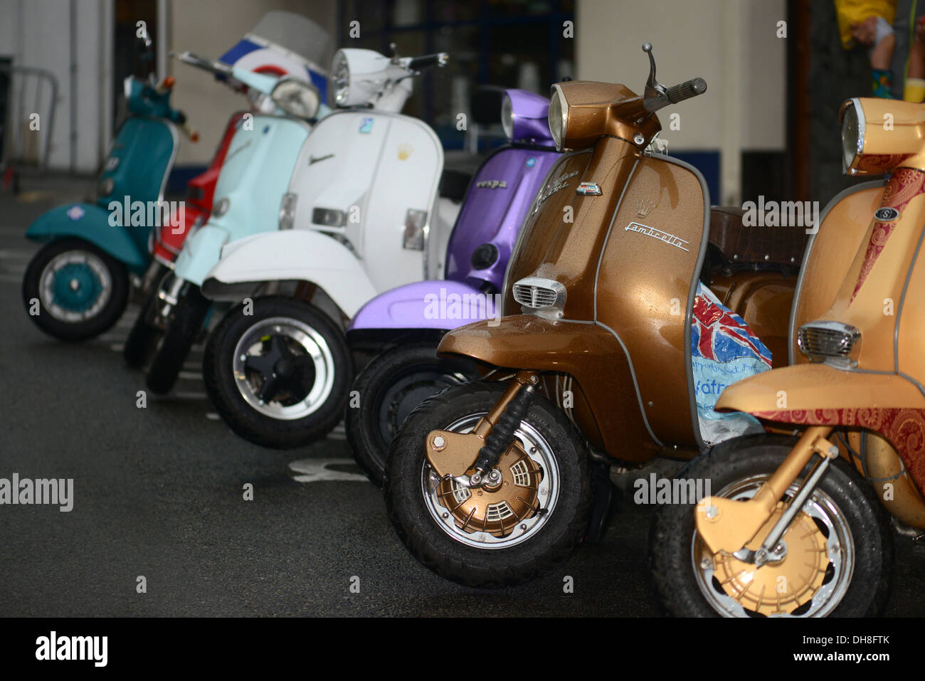 Scooters parked in a parking bay - Stock Image