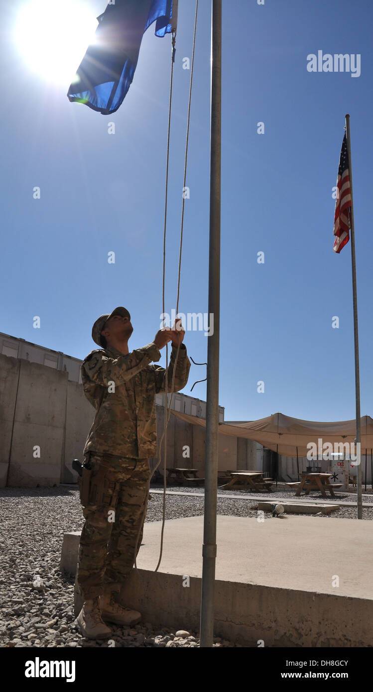 Senior Airman Luther Bernard, 451st Air Expeditionary Wing Command Post controller, is deployed to Kandahar Airfield, Afghanistan, from Aviano Air Base, Italy. Command post controllers have a wide variety of duties at KAF, including raising and lowering t - Stock Image