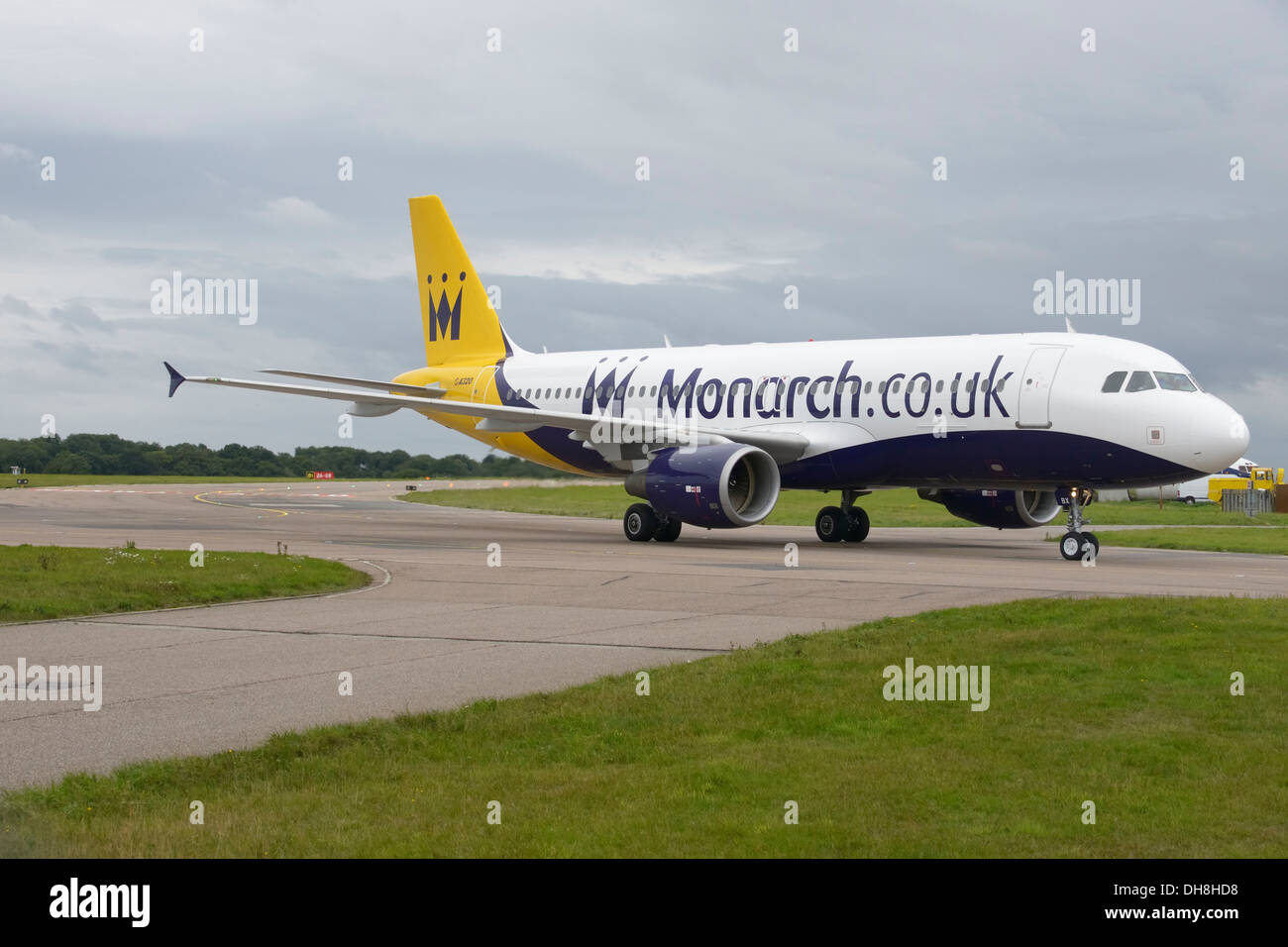 Monarch Airlines Airbus A320-200 taxiing to terminal - Stock Image