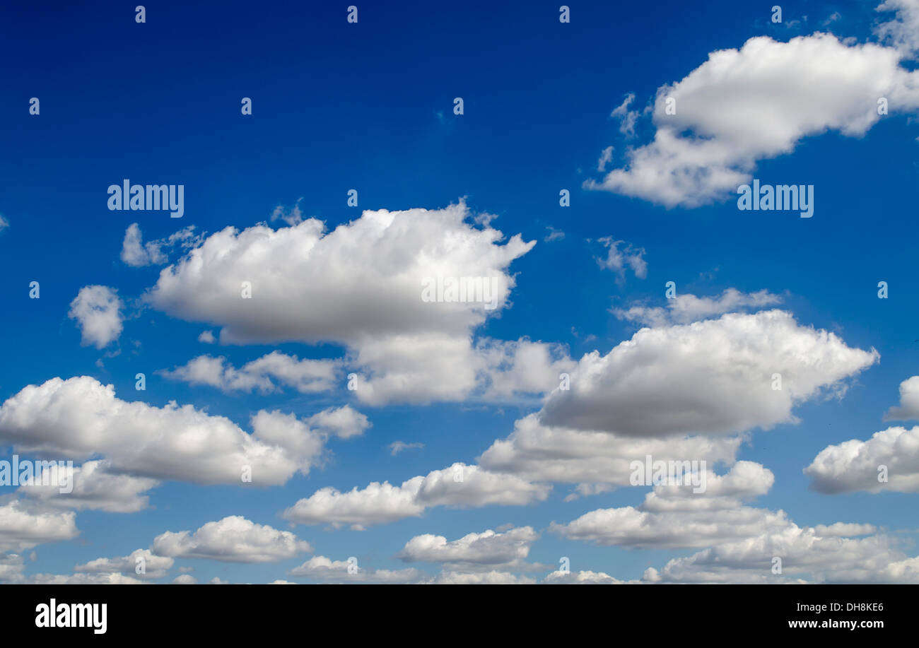 Clouds floating in a blue sky - Stock Image