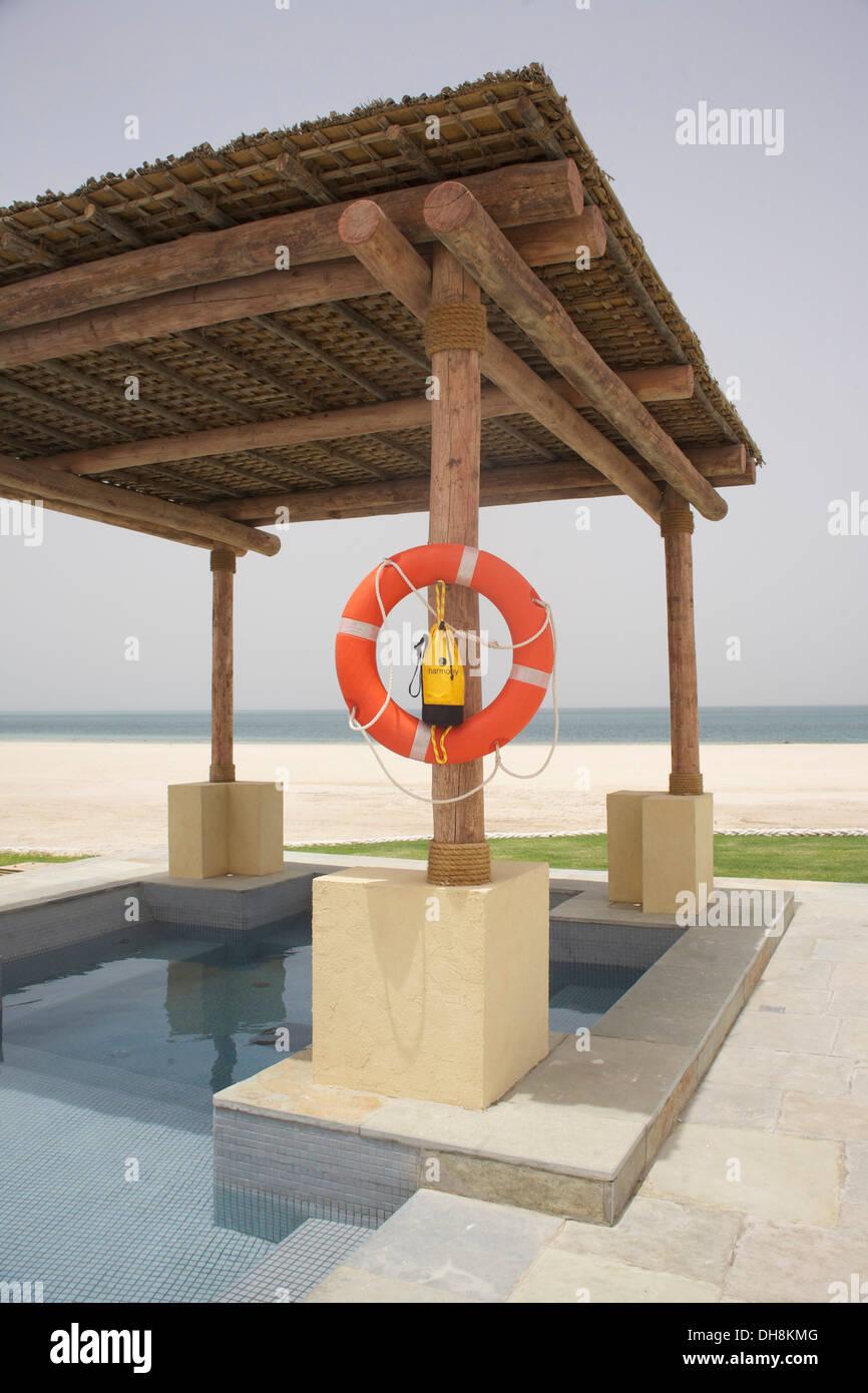 Pool area at new beach villa resort Sir Bani Yas Island, Abu Dhabi - Stock Image