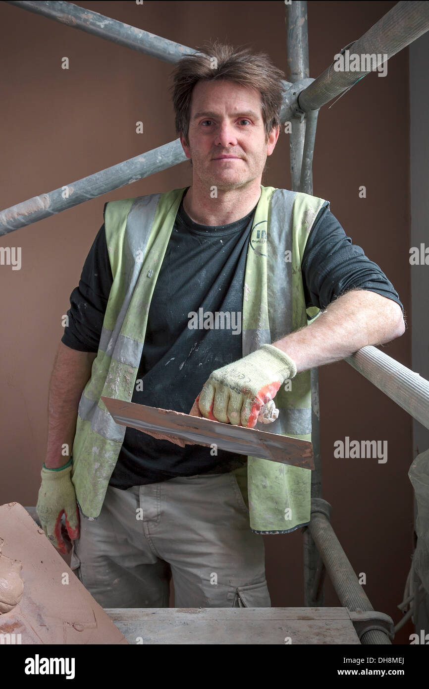 Robert Cochrane, plasterer, working at Fairfield refurbishment, Fairfield, Govan, Glasgow, Scotland, UK - Stock Image