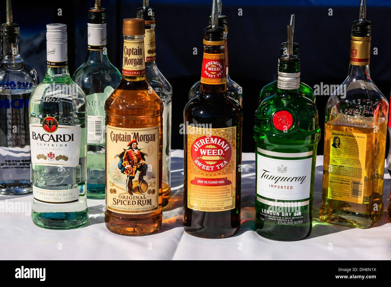 Bottles of hard liquor - Whiskey, Rum, Vodka Stock Photo