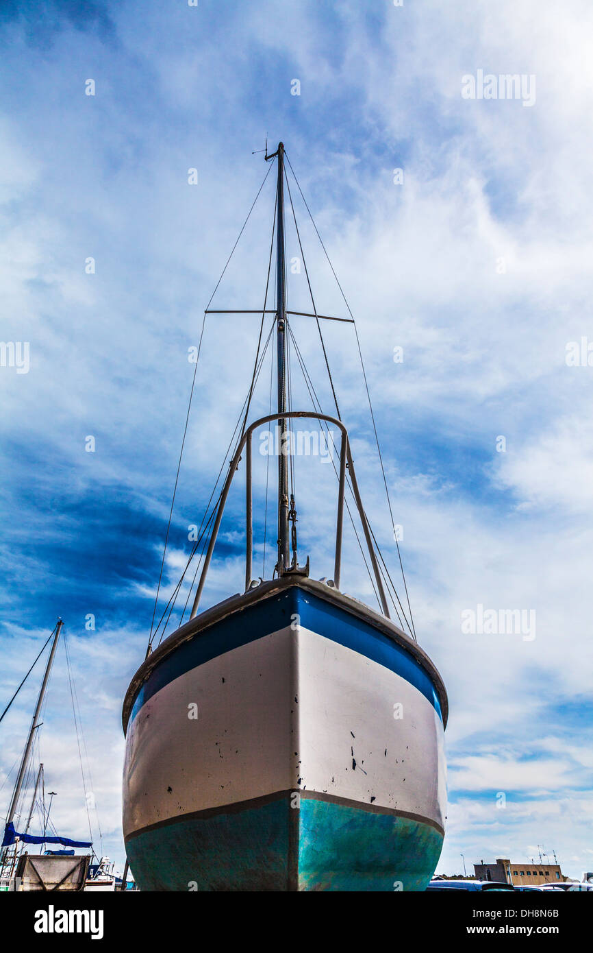 Close-up of the hull of a yacht in dry dock awaiting maintenance and repair. Stock Photo