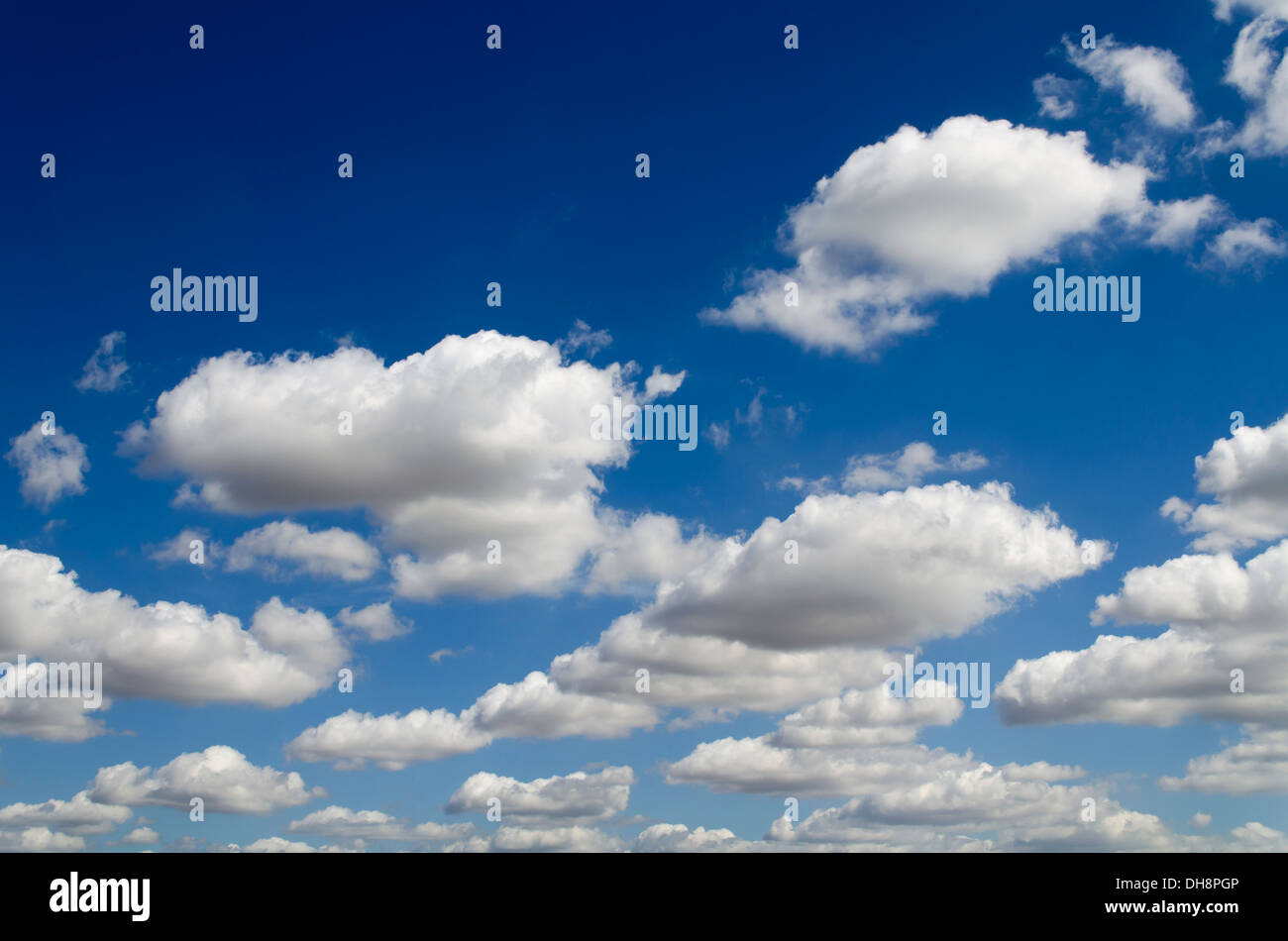 Clouds floating in a blue sky Stock Photo