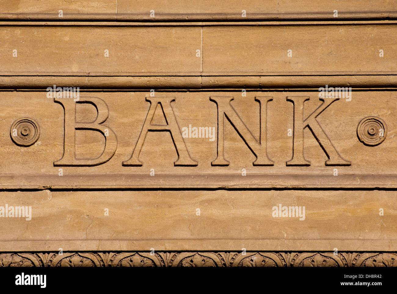 Abstract Bank Sign Carved in Stone Capital Letters - Stock Image