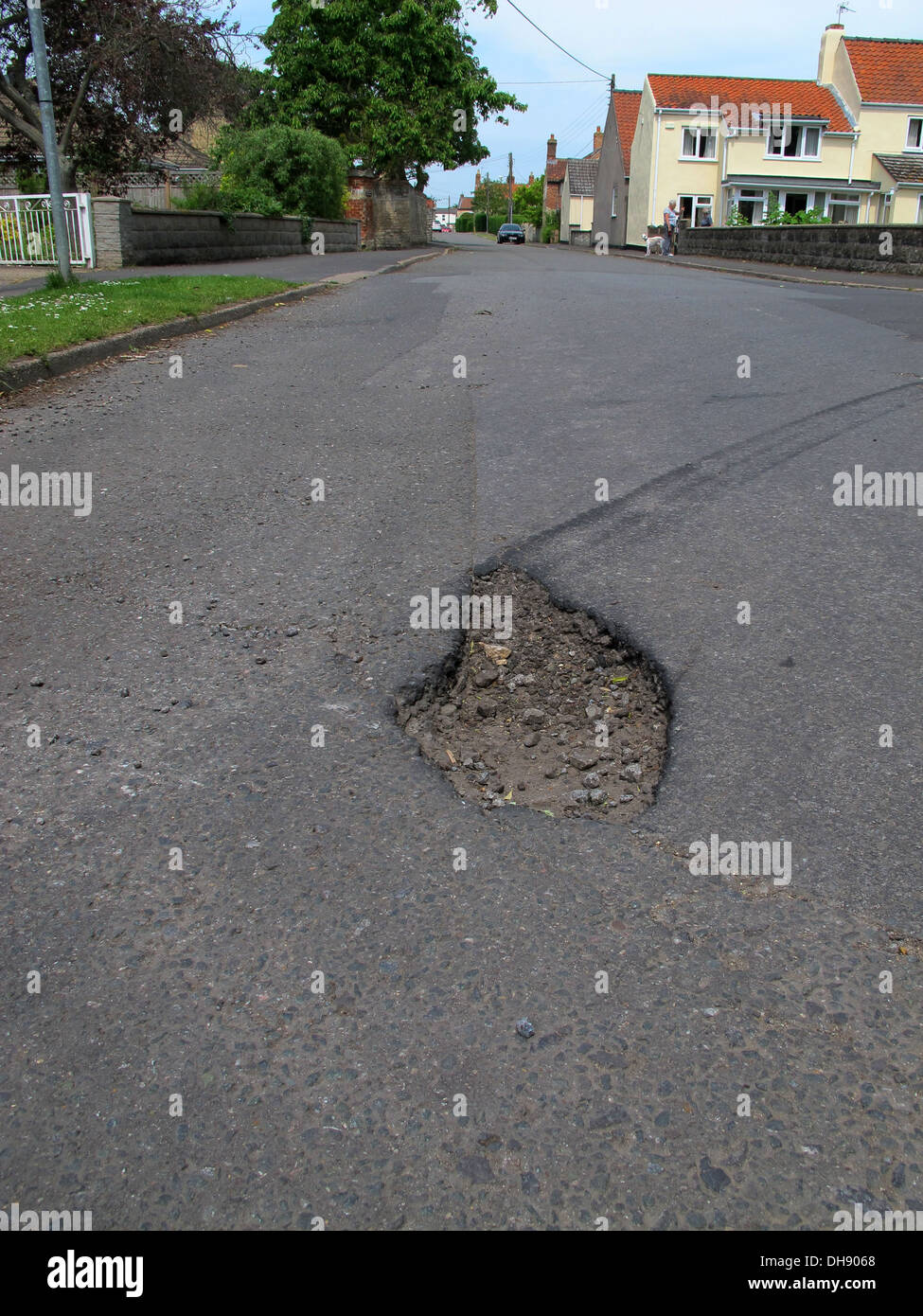With a recent survey showing that two thirds of UK motorists encounter between one and five potholes every day. Stock Photo