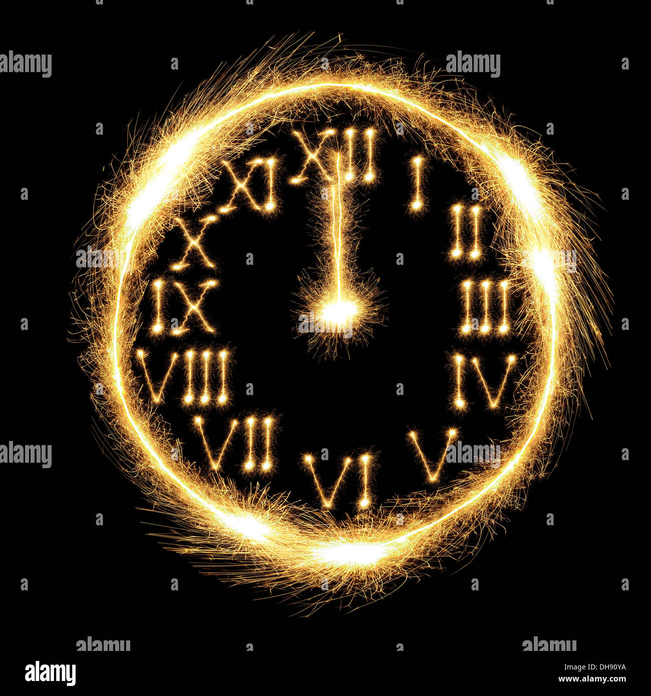 Sparking clock showing almost midnight and the New Year's Day coming - Stock Image