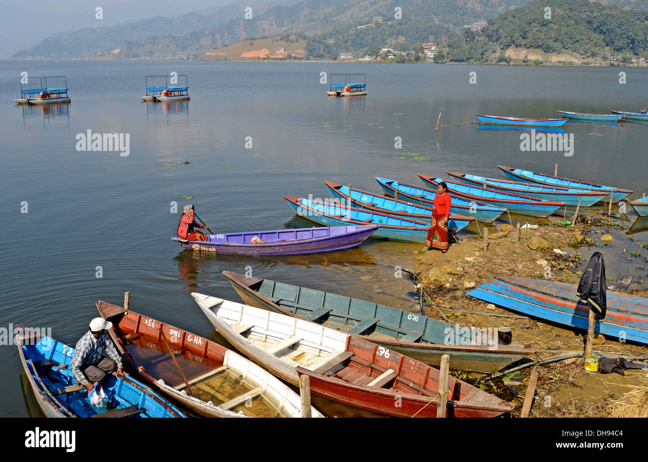 Wooden rowboats in Pokhara lake, or Phewa Lake Nepal - Stock Image