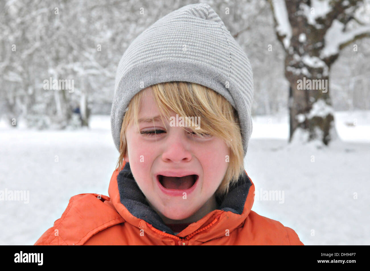 A child snowballing in the snow in winter - Stock Image