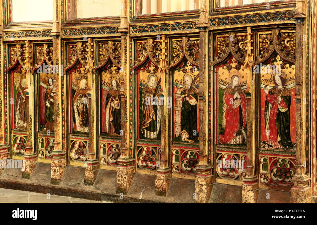Eye, Suffolk, 15th century rood screen, north side, medieval painting paintings saint saints screens England UK - Stock Image