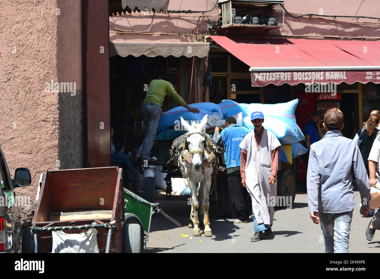 Cart being loaded with goods, ready for the donkey to pull it. - Stock Image