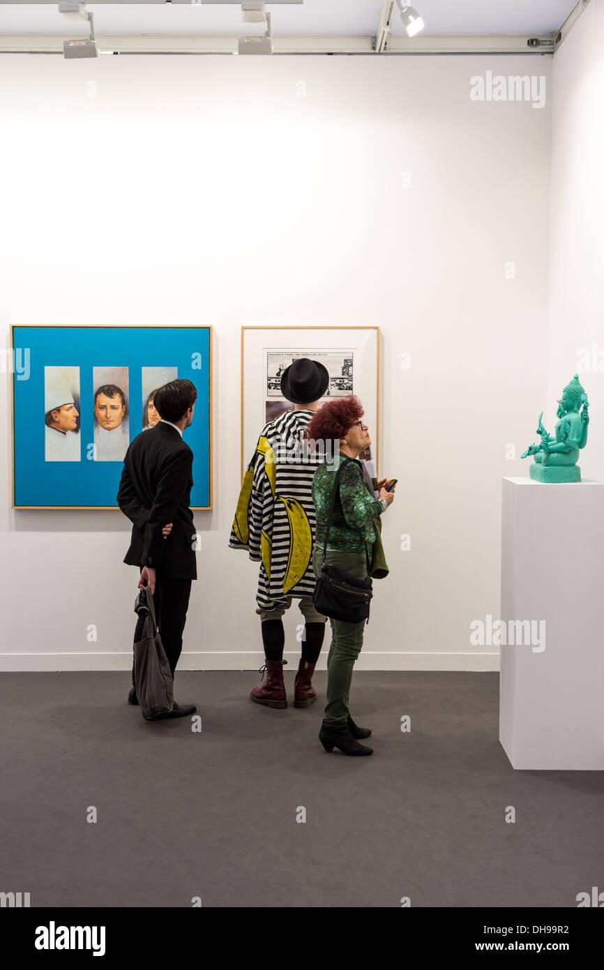 Three visitors visiting the Fiac 2013 (contemporary art fair) at le Grand Palais in Paris, France - Stock Image