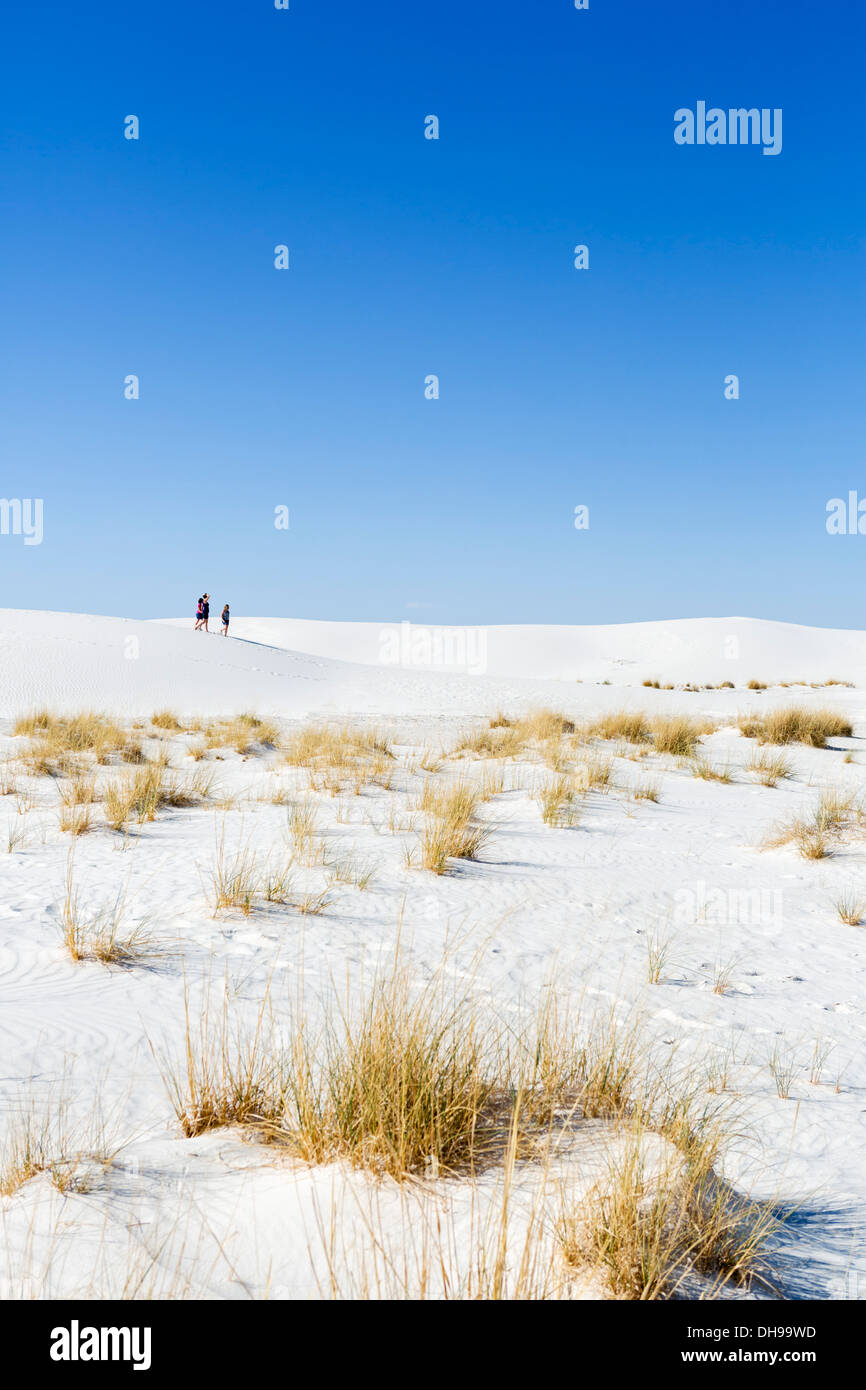 Walkers on the dunes at White Sands National Monument, near Alamogordo, New Mexico, USA - Stock Image